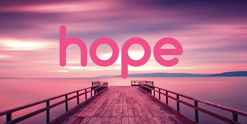 jetty into the see with the words HOPE